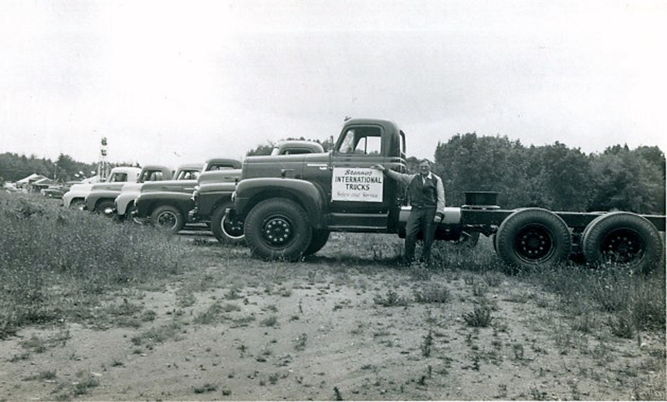 Harold Brenno and his International trucks. Brenno family photo.