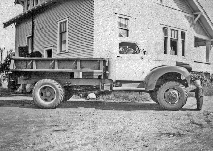 Harold's youngest son George checks out the new Army truck his father bought for a new tow truck, at the family home on the north end. Brenno family photo.