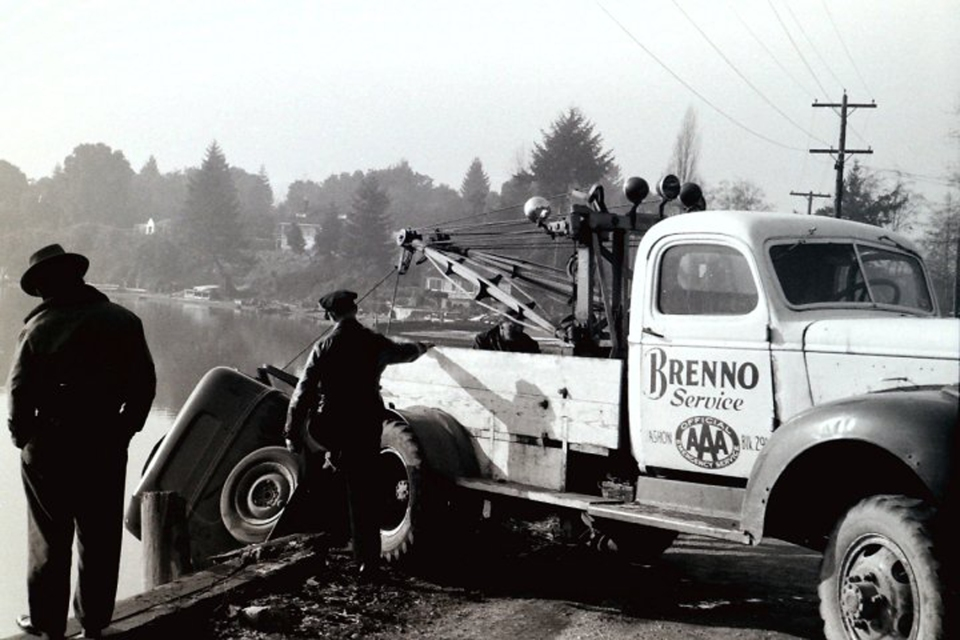 The converted Army truck turned tow truck shown here at work pulling a car off the beach on Quartermaster Drive, in front of Gene Sherman's home. Gene Sherman photo