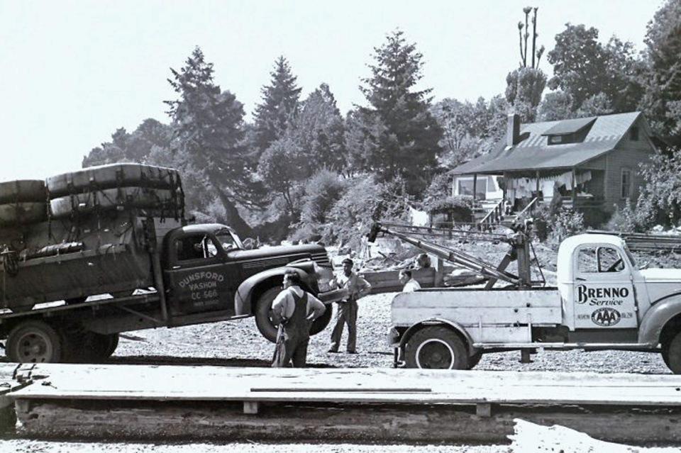 Brenno tow truck unloading rafts for the Sherman's, on Quartermaster Drive. Gene Sherman photo